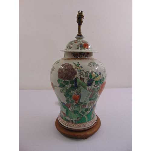 47 - A Chinese famille rose baluster vase and cover converted to a table lamp on raised hardwood stand...