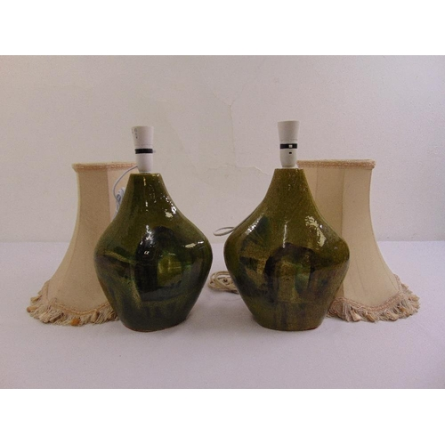 55 - A pair of 1970s porcelain green glazed table lamps with silk shades...
