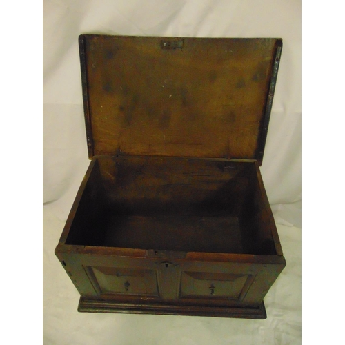 12 - A rectangular oak blanket box with panelled sides and hinged cover...