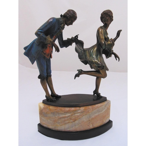 176 - Jaeger cold painted bronze of a gentleman and lady in costume, the polychromatic figurines on an ova...