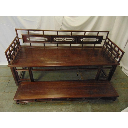 2 - Chinese rectangular hardwood daybed with pierced carved back and matching footstool...