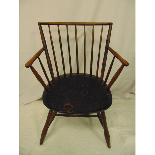 22 - An early oak spindle back chair on four turned cylindrical legs...