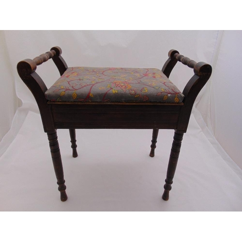 23 - A mahogany rectangular piano stool with hinged upholstered seat on four turned legs...