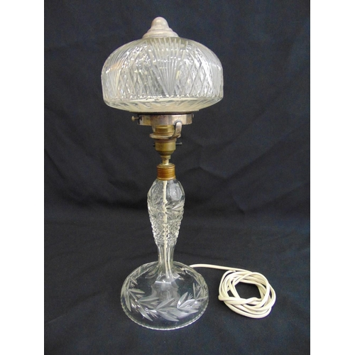 28 - Cut glass table lamp of baluster form on raised circular base with detachable cut glass shade, 41.5c...