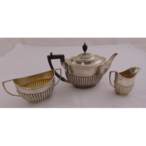 312 - An Edwardian silver three piece teaset, oval, part fluted with angled handles, the teapot London 190...