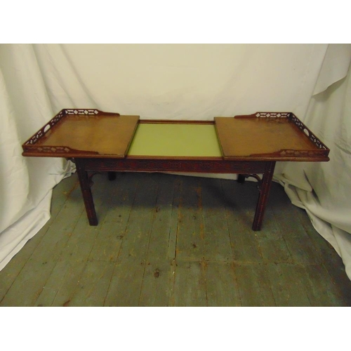 4 - A Chinese style rectangular coffee table with pierced gallery and leather top opening to reveal a gl...