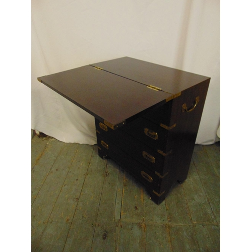 5 - A rectangular mahogany brass bound campaign chest of drawers with inset handles and hinged top on fo...