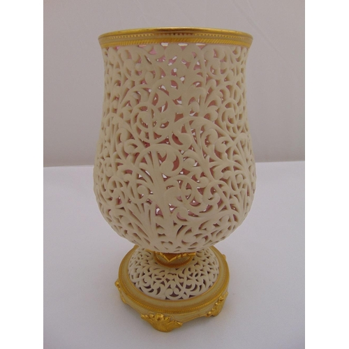 72 - A Graingers Royal Worcester reticulated vase on raised circular base with gilded rim and decorations...