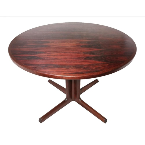 9 - A mid 20th century rosewood circular pedestal dining table by Gudme Møbelfabrik of Denmark on tubula...