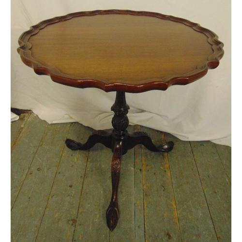 11 - A Victorian mahogany tilt top piecrust wine table on three outswept legs, 64cm (h) 62cm (dia)...