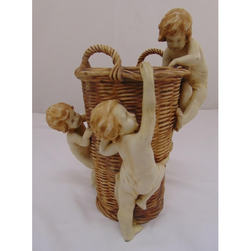 158 - An Austrian late 19th century ceramic vase in the form of a basket with three applied putti, 33cm (h...