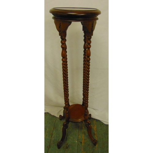 16 - A mahogany plant stand with barley twist supports and four outswept feet, 101cm (h)...