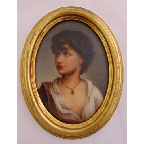 223 - A framed oval oil on porcelain portrait of a young lady wearing a gold necklace, 17 x 12cm...