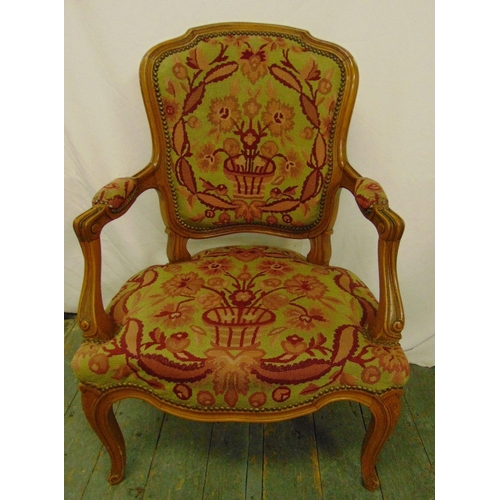 23 - A mahogany armchair with upholstered tapestry seat and back on cabriole legs...