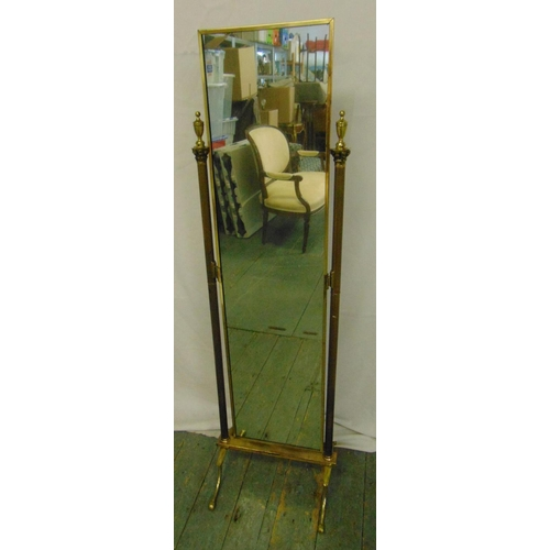 26 - A gilded metal rectangular cheval mirror with urn finials to the sides on four scroll supports, 137c...