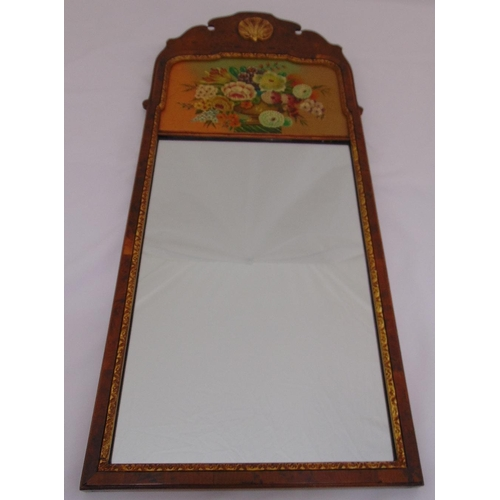 28 - A rectangular wall mirror in 18th century style, the top painted with flowers and leaves, 79.5 x 35c...