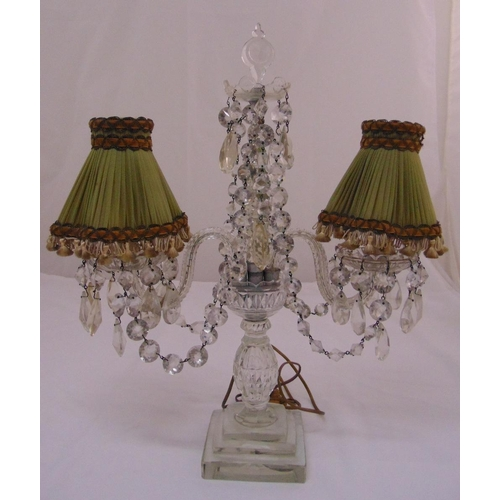 31 - A 19th century crystal two branch lamp stand with crystal drops on stepped square base, 53cm (h)...