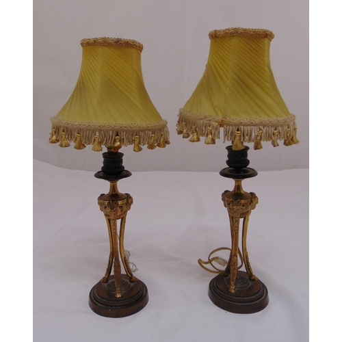 33 - A pair of gilded metal table lamp stands on raised circular bases with shades, 38cm (h)...
