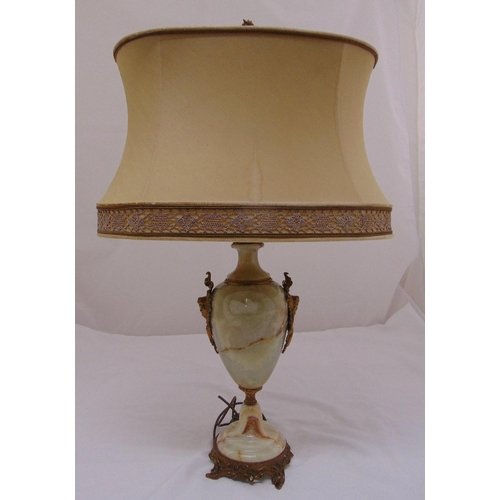 38 - An onyx baluster form table lamp with gilt metal mounts on circular base, to include shade, 78cm (h)...