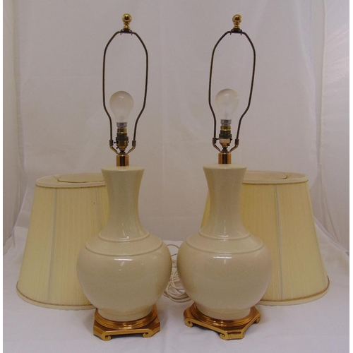 39 - A pair of porcelain baluster form table lamps to include shades, 76cm (h)...