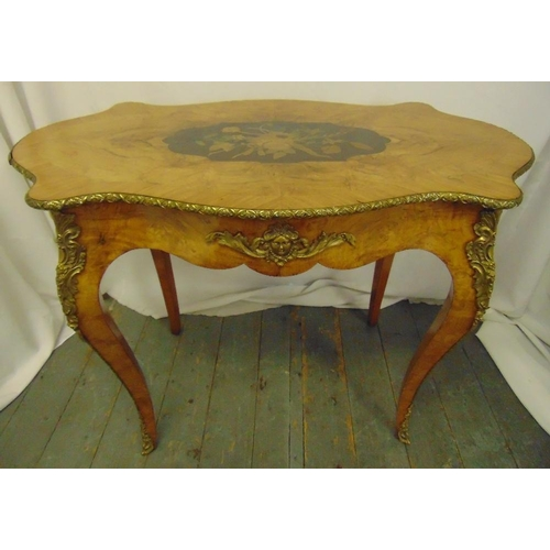9 - A 19th century Louis XVI style shaped rectangular hall table with gilt metal mounts, on four cabriol...
