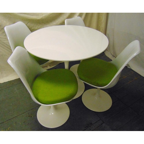 1 - A mid 20th century circular white Tulip table and four matching chairs with detachable cushions, tab...