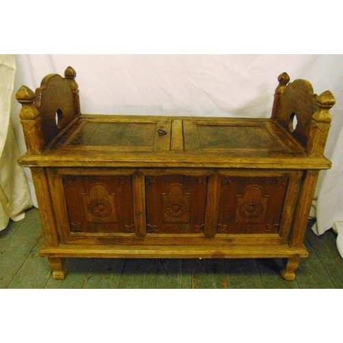 12 - A late 19th century ottoman of rectangular form with two hinged seats, panelled sides on four rectan...