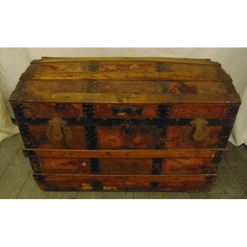 14 - A late 19th century rectangular steamer trunk with metal and wooden bands and domed hinged cover, 55...