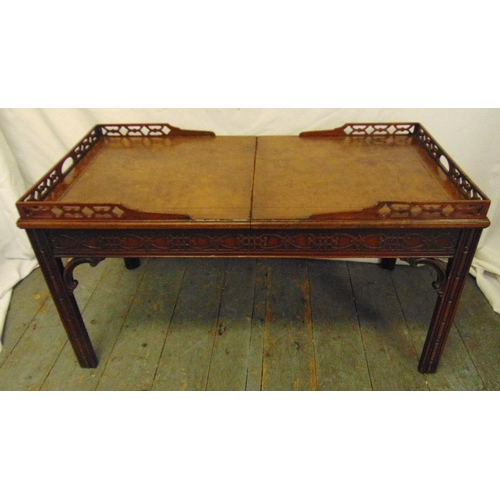 16 - A Chinese style rectangular coffee table with pierced gallery and leather top opening to reveal a gl...