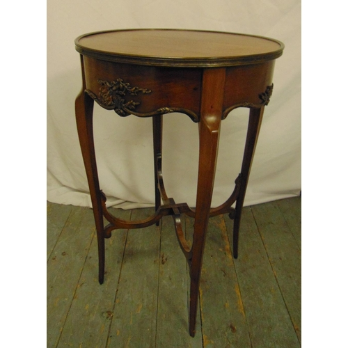 18 - A mahogany circular occasional table on four tapering sabre legs, 77 x 48.5cm...