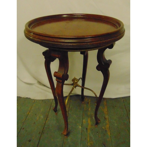 19 - A mahogany circular side table on four cabriole legs, 61 x 40cm...