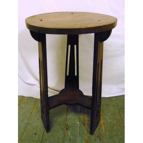 20 - An early 20th century oak circular Arts and Crafts three legged occasional table, 69 x 42.5cm...