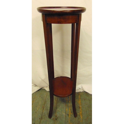 25 - A mahogany plant stand, circular on four tapering rectangular legs, 94.5cm (h)...