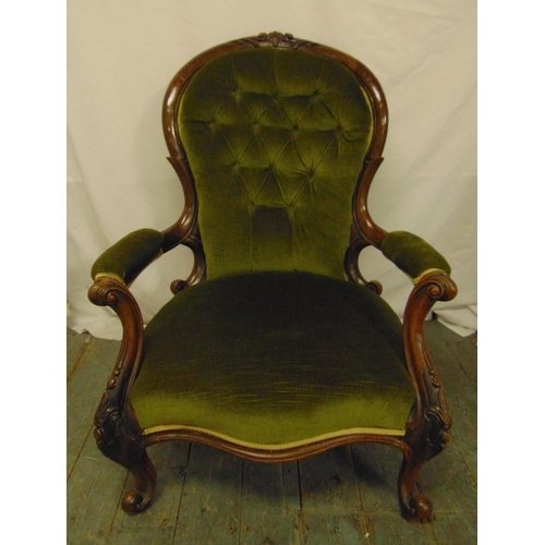 31 - A Victorian mahogany button back upholstered armchair on carved cabriole legs, 94 x 71 x 74cm...