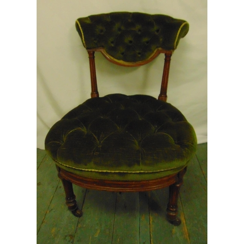 32 - A Victorian mahogany button back upholstered nursing chair on turned cylindrical legs, 67 x 48 x 64c...