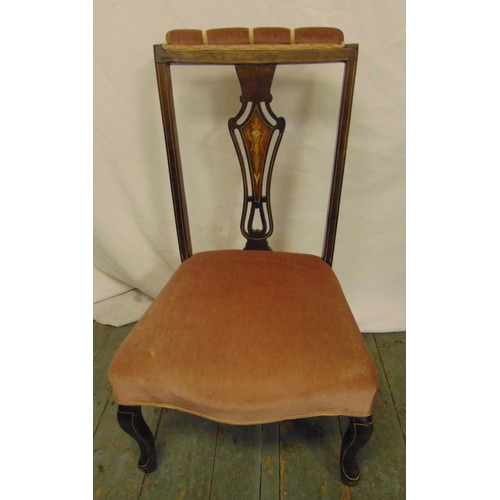 35 - An Edwardian upholstered nursing chair with satinwood stringing, on four scroll legs...