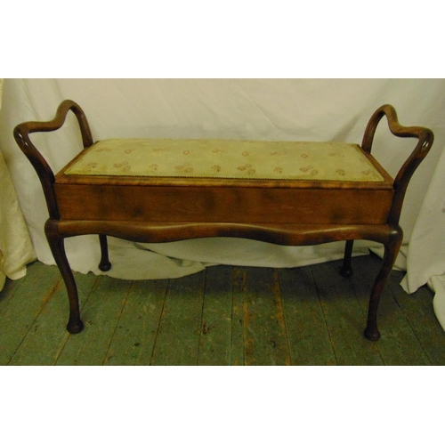 39 - A mahogany rectangular piano stool with upholstered hinged seat, scrolling sides and legs, 64.5 x 99...