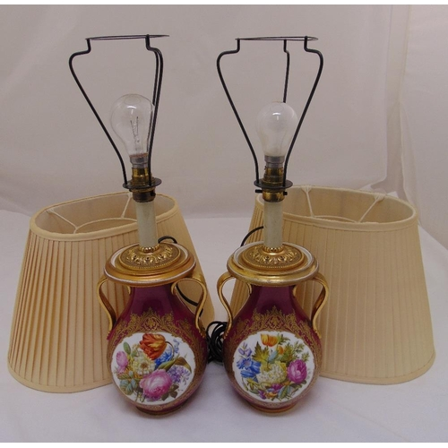 43 - A pair of continental lamp bases, Viennese style, baluster form, decorated with floral sprays to inc...