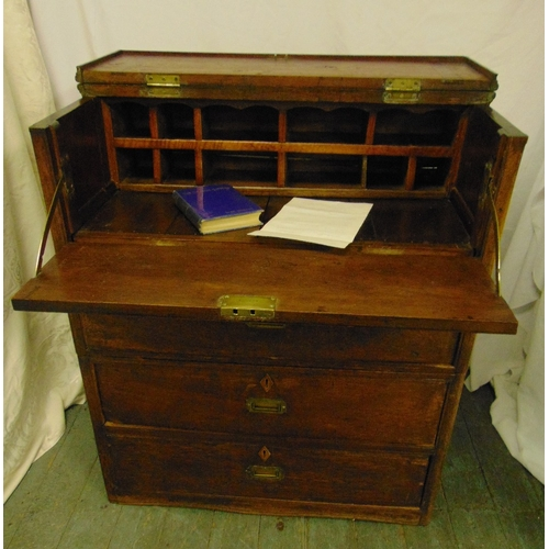 10 - A Colonial Clipper rectangular oak sea chest with three drawers and hinged top section revealing a w...