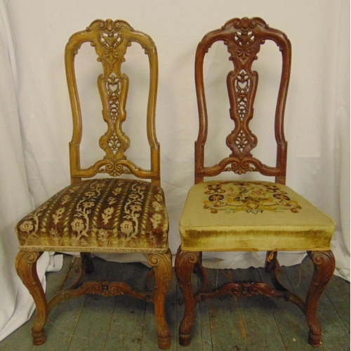15 - A pair of continental mahogany hall chairs with upholstered seats and cabriole legs...