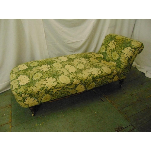 16 - A late Victorian upholstered chaise longue/day bed on four turned cylindrical legs, 68 x 168 x 70cm...