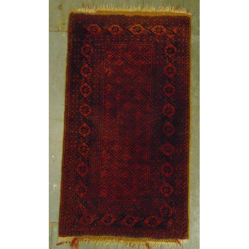 22 - Two Persian rugs, red ground with repeating motif patterns and borders A.140 x 80cm B.144 x 106cm...