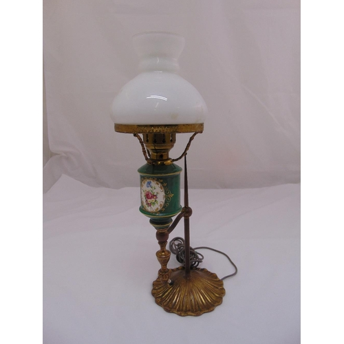 29 - A porcelain and brass table lamp with detachable glass dome...