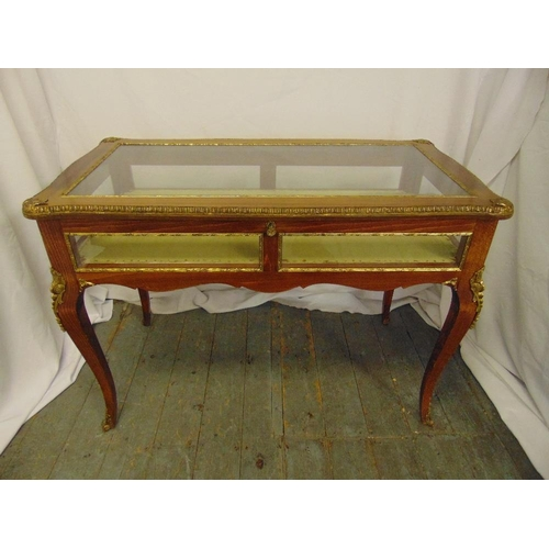 3 - A Louis XVI style rectangular mahogany and gilt metal bijouterie display table with glazed sides on ...
