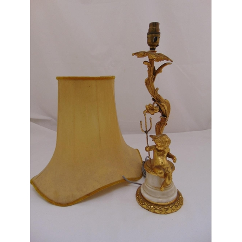 30 - An ormolu and marble table lamp with applied putti holding a trident on tapering cylindrical base to...