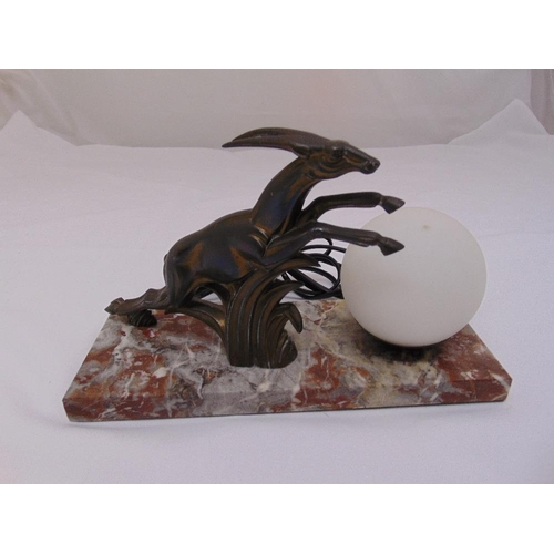 31 - A bronze Art Deco table lamp of globular form with leaping gazelle on a rectangular marble base, 17 ...
