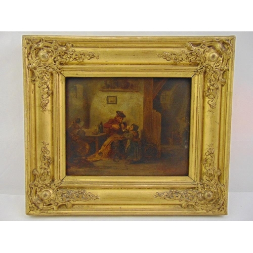 55 - A framed early 19th century oil on board of an interior scene with child lighting the pipe of a seat...