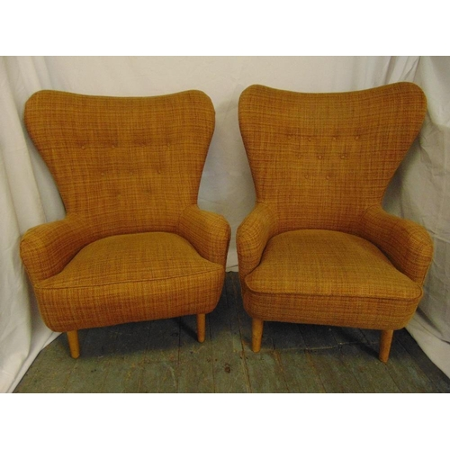 7 - A pair of Ernest Race mid 20th century DA upholstered armchairs, metal base on four tubular beech le...