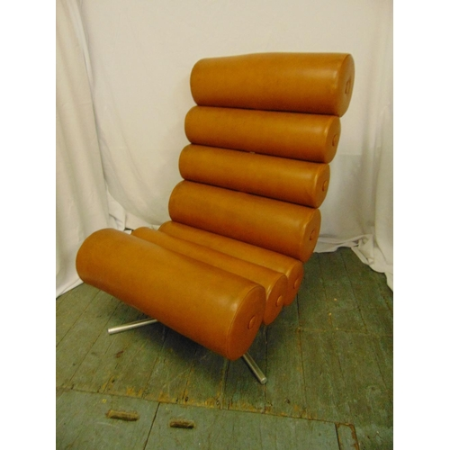 8 - A mid 20th century brown faux leather (sausage) chair of tubular sections on triform metal base, 100...