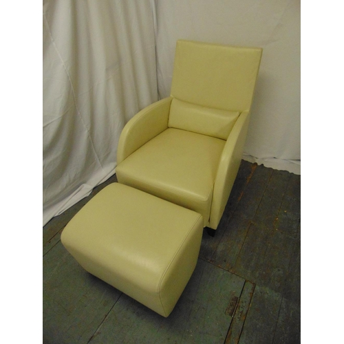 9 - A cream leather occasional chair and matching footstool by Ligne Roset...
